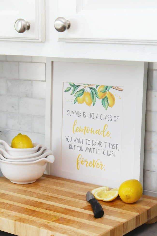 Summer is like a glass of lemonade free summer printable displayed in a summer kitchen.