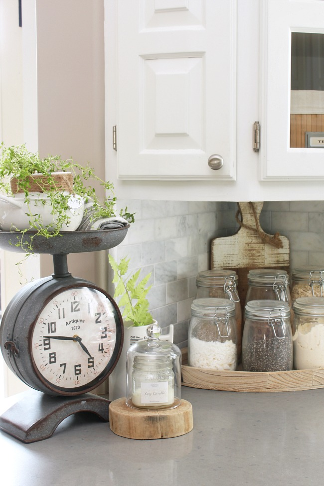 Farmhouse style clock scale in a white kitchen.