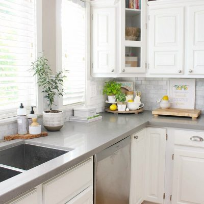 White farmhouse style kitchen with simple summer decor.