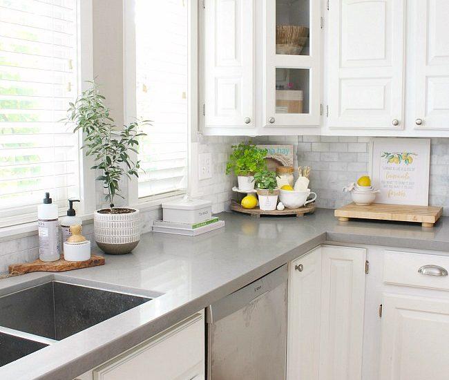 White farmhouse style kitchen with simple summer decor.