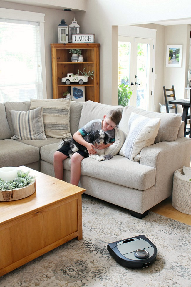 Time saving cleaning tips. Neato D7 vacuum in a farmhouse style family room.