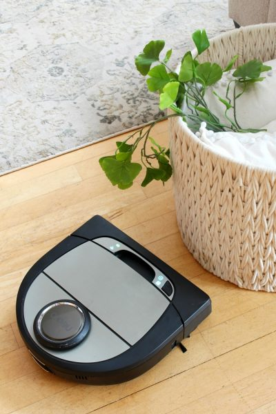 Neato D7 robotic vacuum on a hardwood floor.