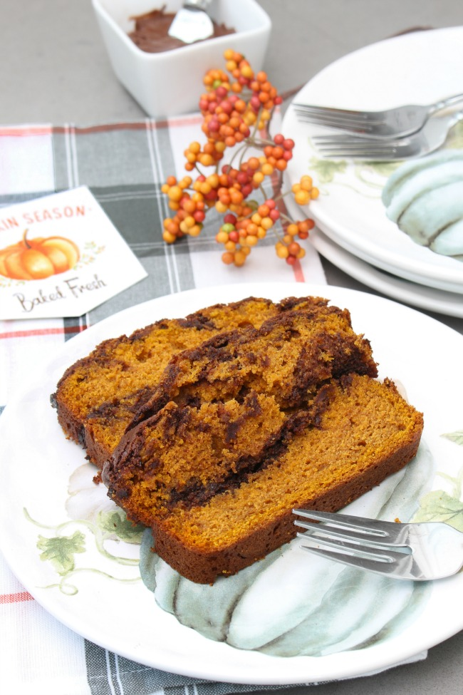 2 slices of pumpkin Nutella swirl bread on a fall plate with a free printable fall baking tag.