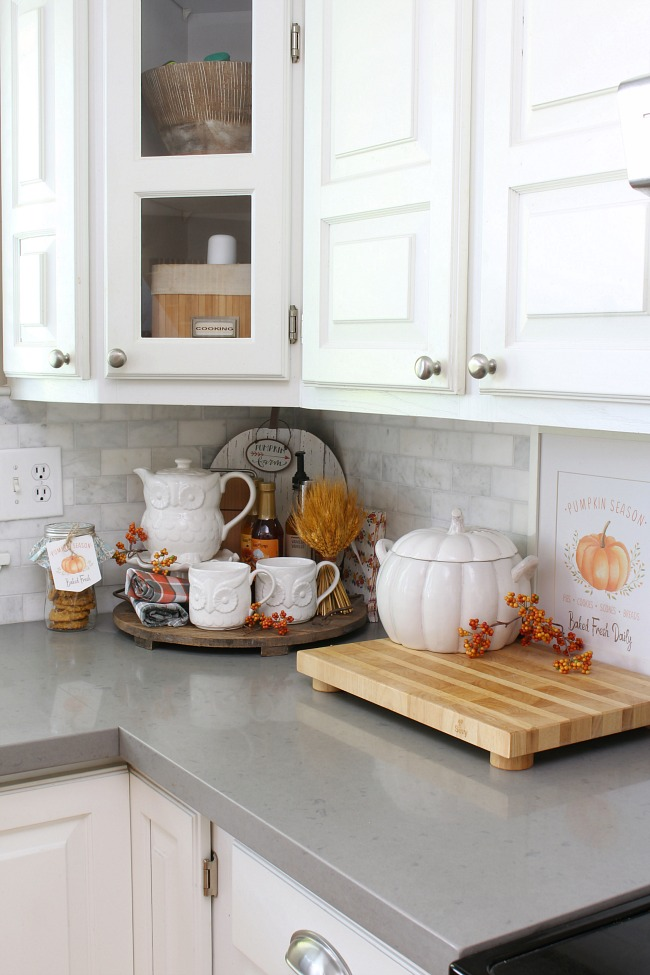 Modern farmhouse kitchen decorated for fall.