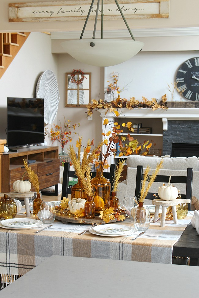 Beautiful amber glass and muted fall colors in a farmhouse style kitchen.
