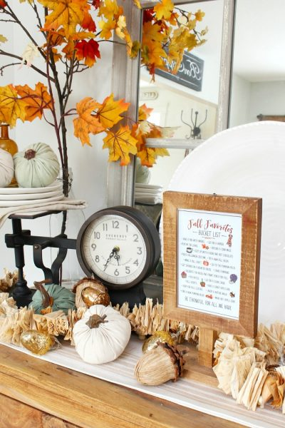 Fall favorites fall bucket list displayed in a wood frame.