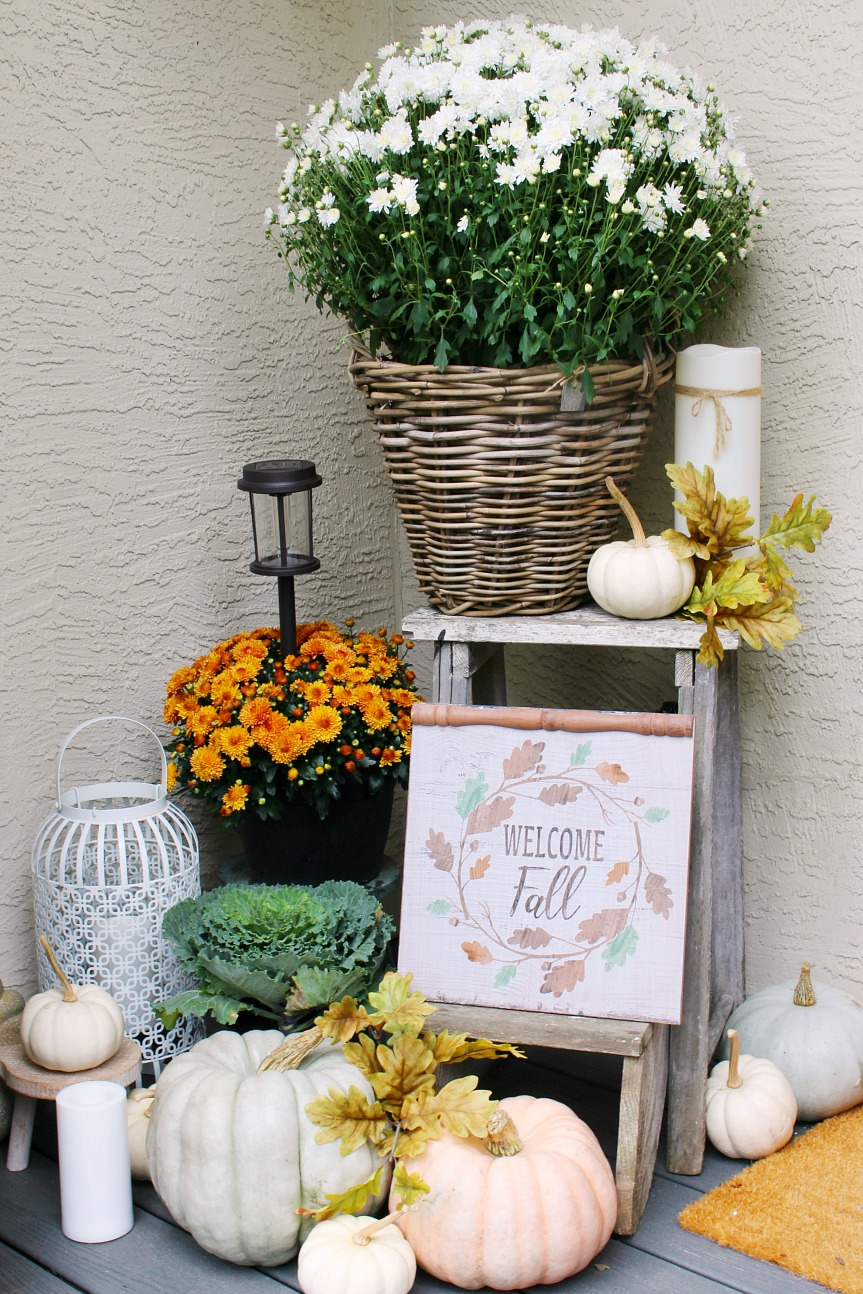 Colorful fall front porch with mums, pumpkins and a few vintage touches.