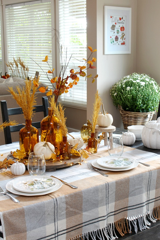 Harvest moon fall tablescape ideas for fall or Thanksgiving. Beautiful amber glass and muted fall colors in a farmhouse style kitchen.