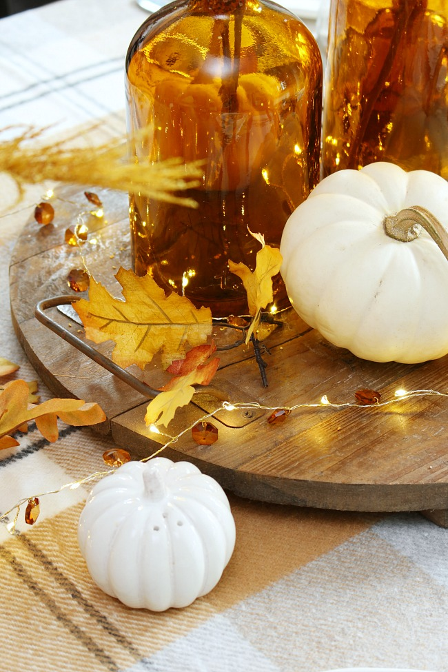 Pumpkin salt and pepper shakers on a harvest moon fall tablescape.