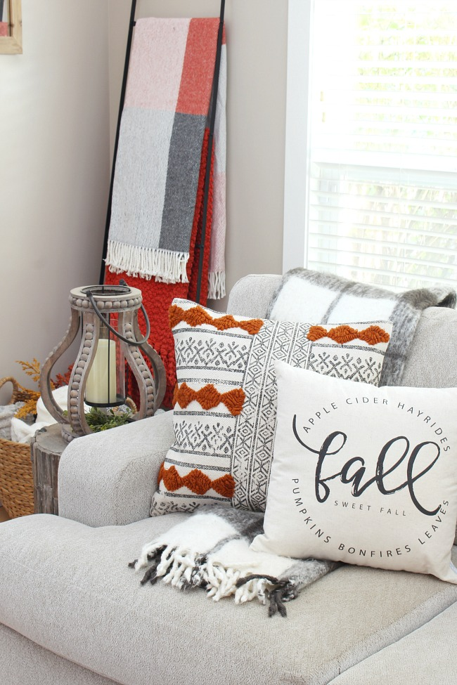 Cozy fall living room with fall pillows and cozy throws.