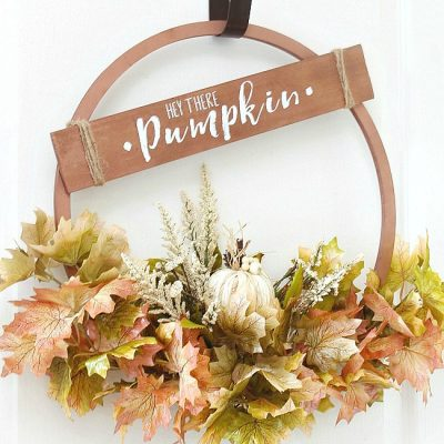 Beautiful copper hoop wreath for fall with 'Hey There Pumpkin' sign.