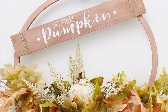 'Hey There Pumpkin' fall sign on a copper hoop wreath.