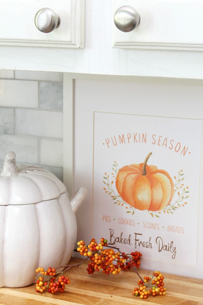 Farmhouse style 'Pumpkin Season' free fall printable displayed in a frame.