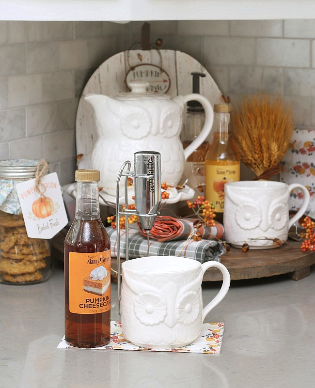 Cute fall beverage bar with owl tea set and fall-flavored syrups.