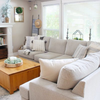 Beige sectional in a modern farmhouse style family room.