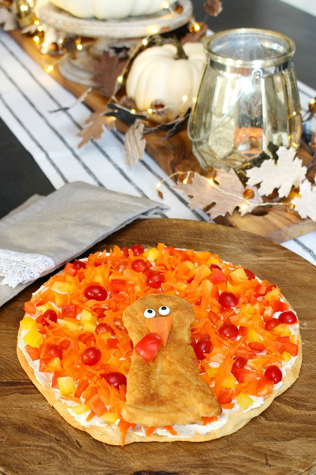 Turkey veggie pizza appetizer on a table decorated for Thanksgiving.