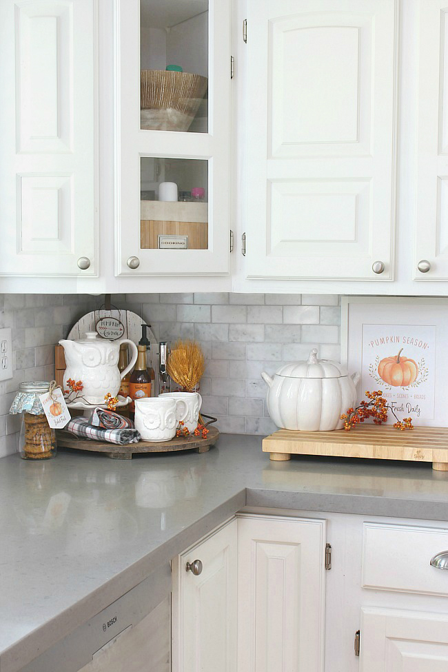White fall kitchen decorated for fall with a cute fall beverage bar and free fall printable.