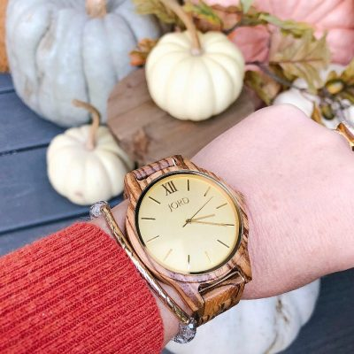 Jord wood watch with pumpkins in background.