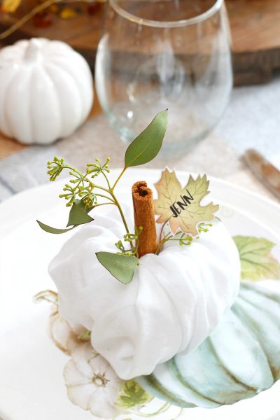 Cute napkin fold pumpkins for Thanksgiving place settings.