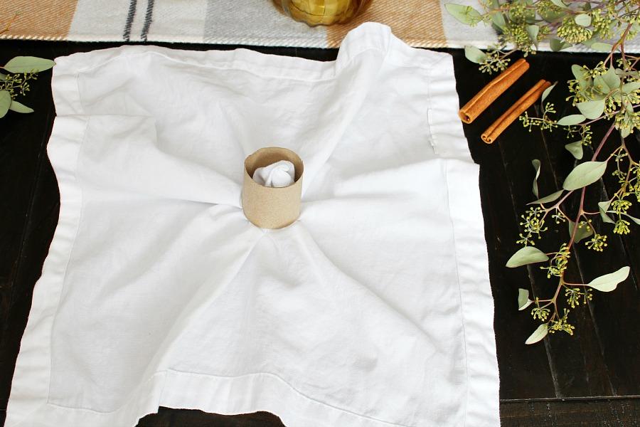 Pumpkin napkin folding tutorial step 1.