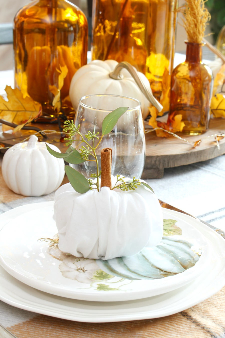 Thanksgiving place settings with cute napkin fold pumpkins.