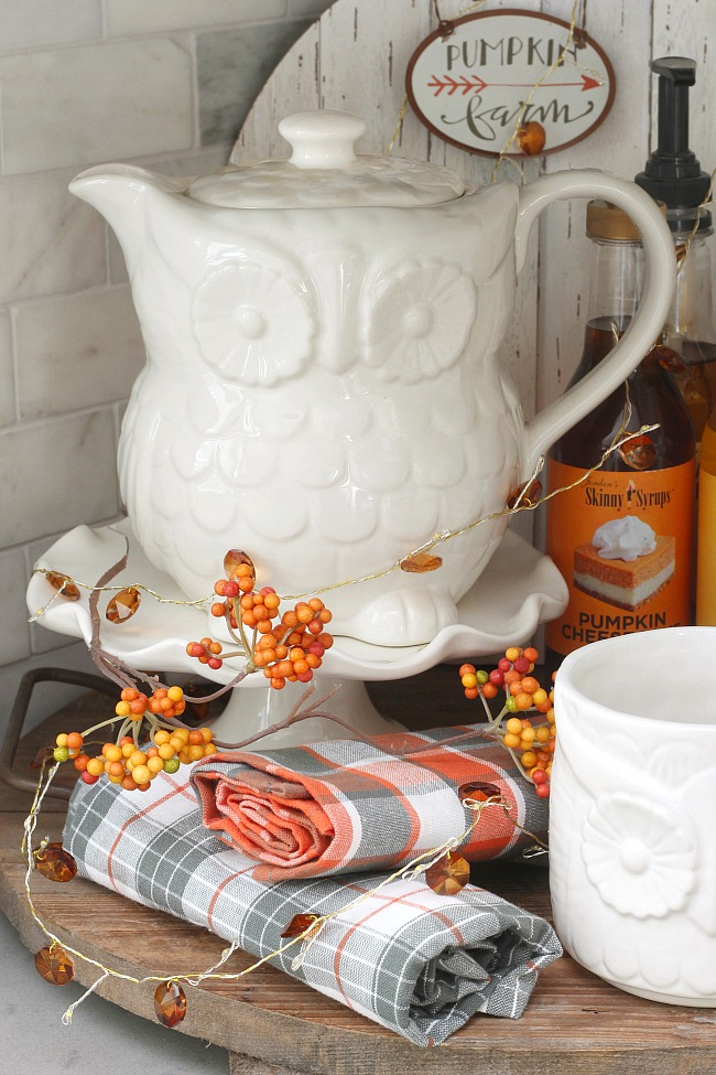 Fall beverage bar with a white owl teapot.