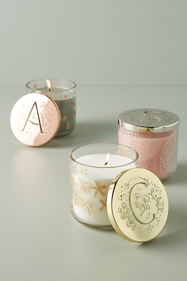 Monogrammed candles in pretty jars.