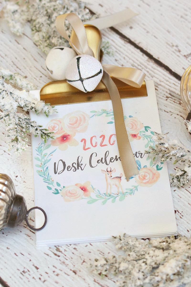 2020 free printable desk calendar with a brass bulldog clip.