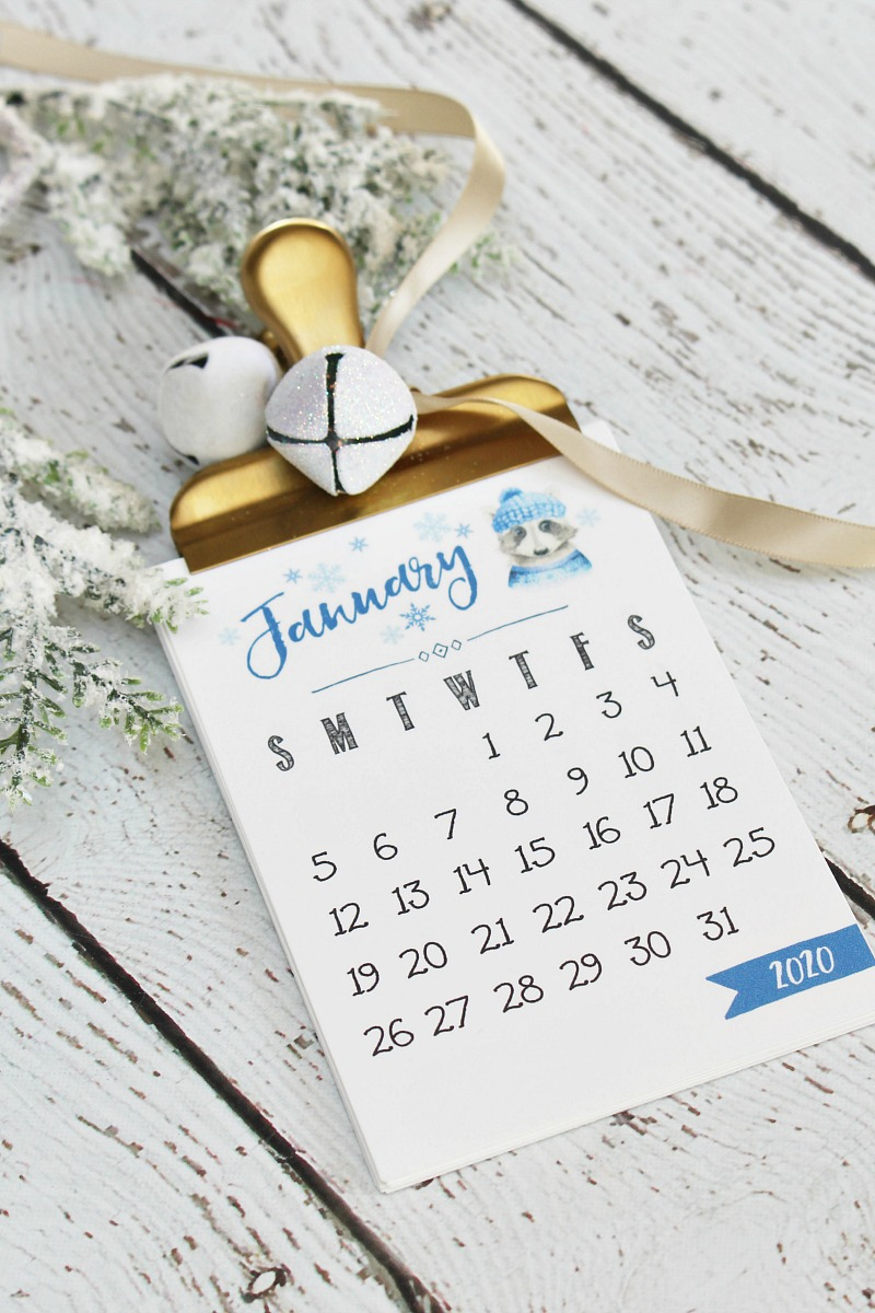 Free printable 2020 calendar packaged up with an oversized gold bulldog clip.