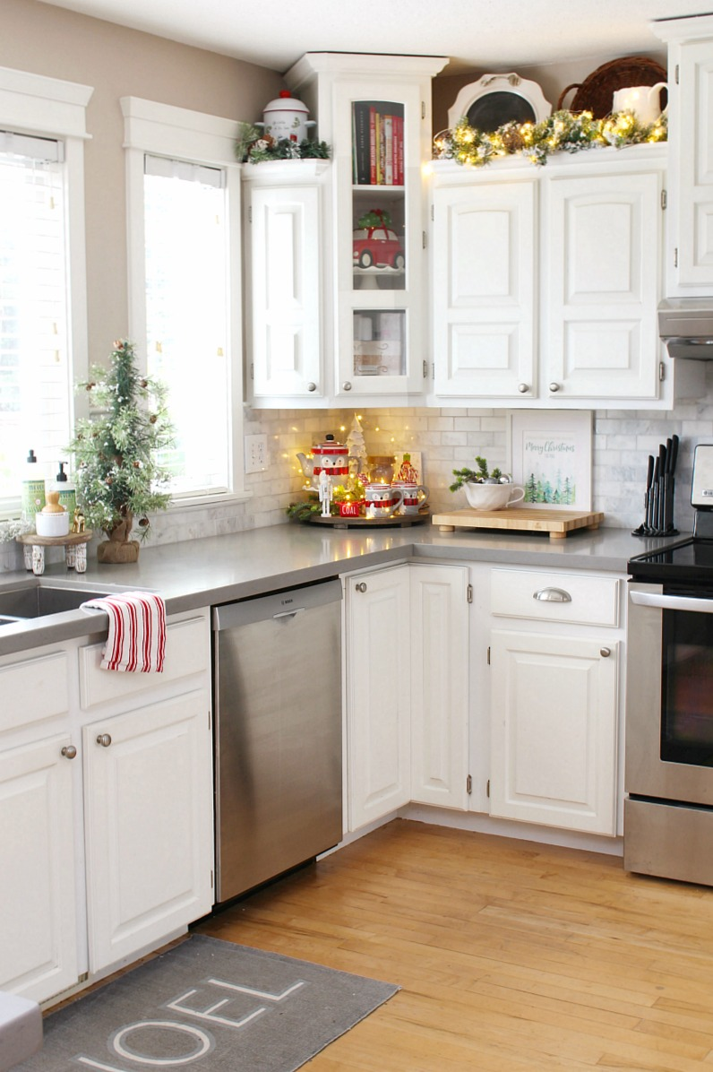 White modern farmhouse style kitchen decorated for Christmas.
