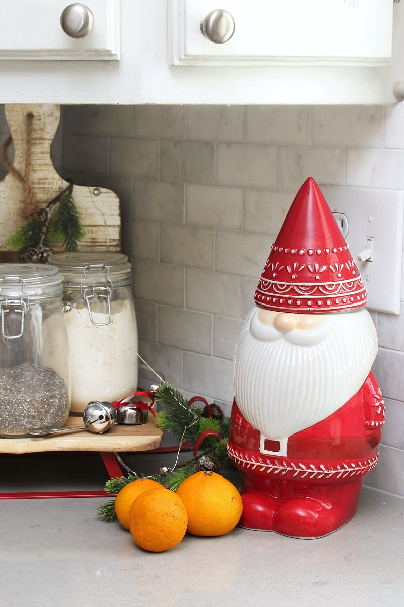 Christmas gnome cookie jar with mandarin oranges.