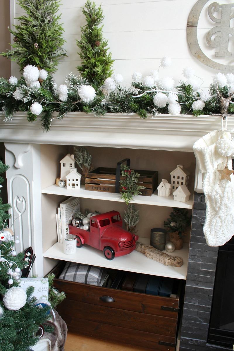 Christmas mantel with shelves decorated for Christmas.