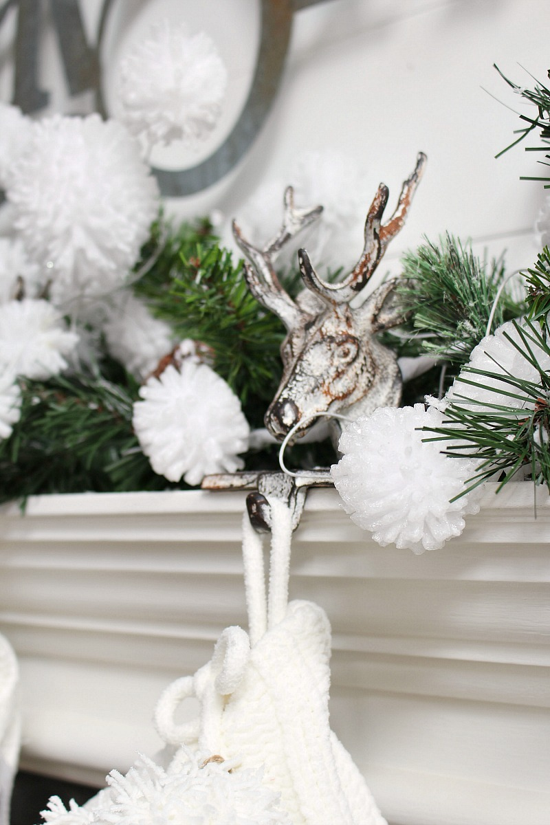 Christmas mantel with rustic reindeer stocking holders.