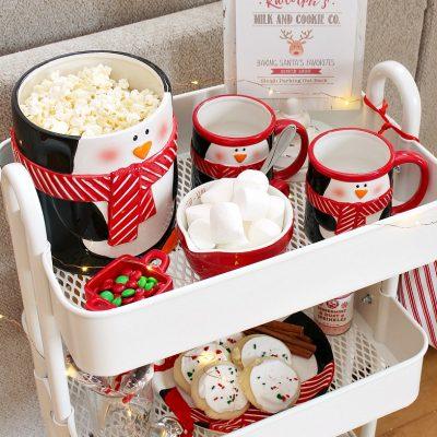Christmas movie night cart with popcorn, hot chocolate and Christmas treats.
