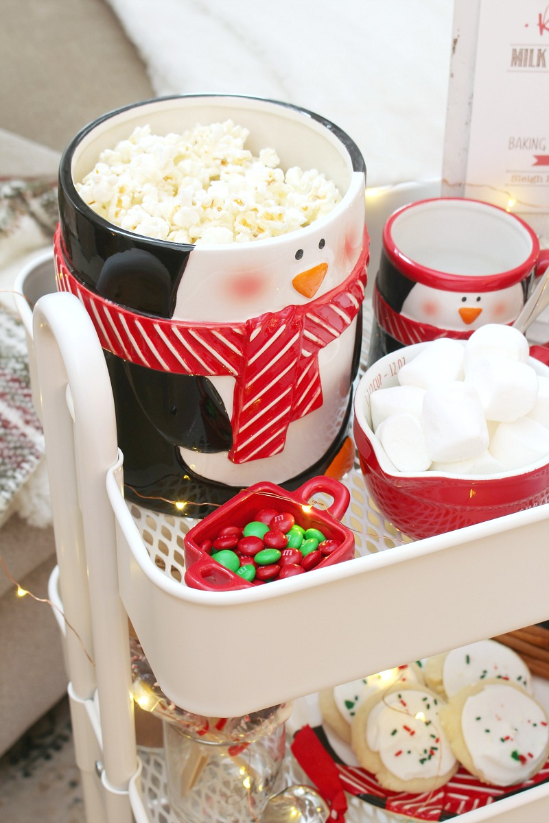 Christmas movie night cart with a cookie jar used as a popcorn bowl.