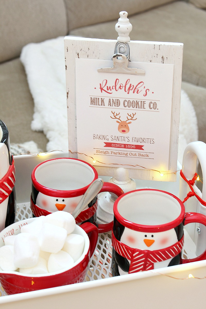 Christmas movie night cart with Christmas penguin mugs and free Christmas printable.