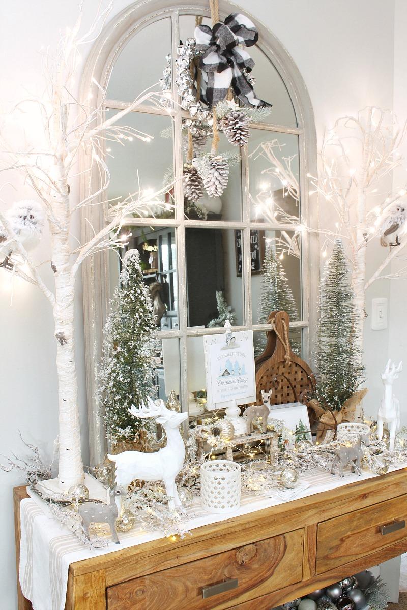 Christmas side board decorated with reindeers, twinkle lights and a cute Reiendeer Ridge Christmas printable.