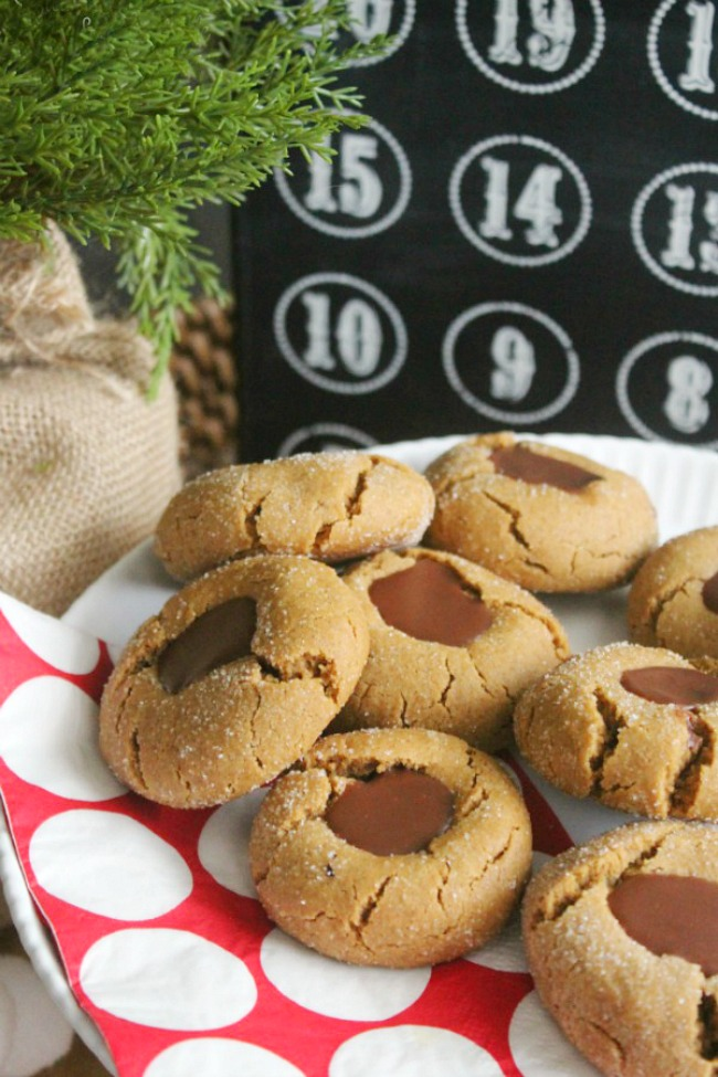 Gingerbread chocolate thumbprint cookies on a plate with Christmas countdown.