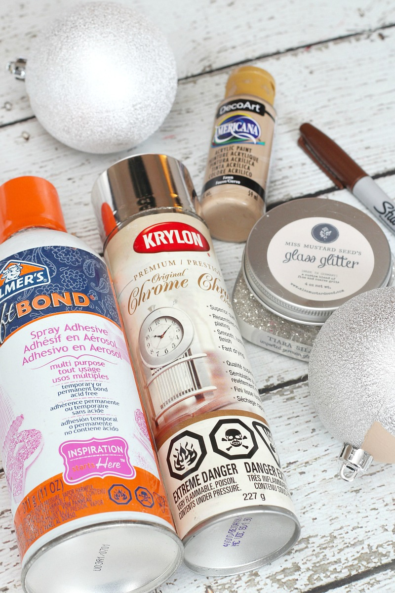 Craft supplies for DIY reindeer Christmas ornaments.