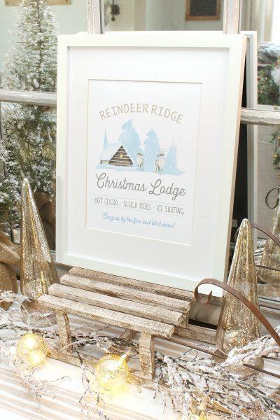 Reindeer Ridge Christmas Lodge free Christmas printable on a wood sled.