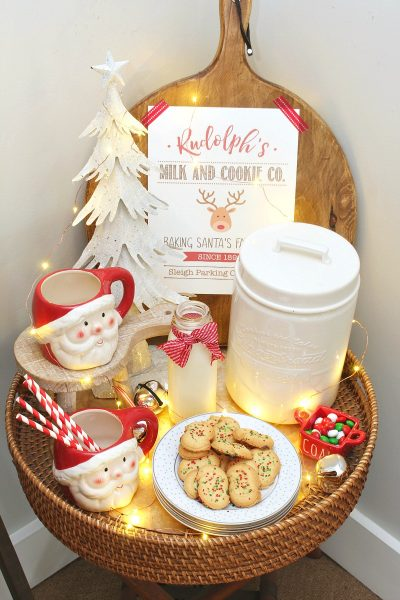 Christmas milk and cookie bar wth Santa mugs and cute Rudolph's Milk and Cookie Co. free Christmas printable.
