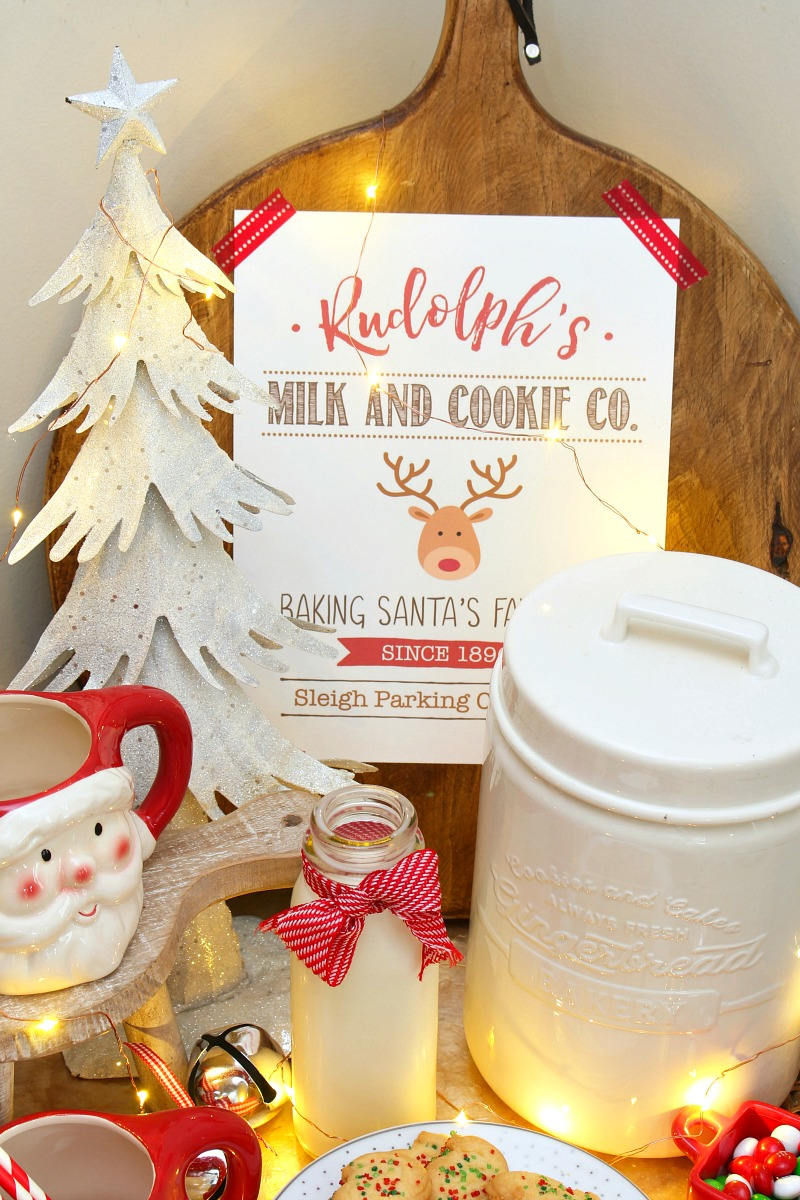 Cute milk and cookie bar with Santa mugs and Chrismas milk and cookies printable.