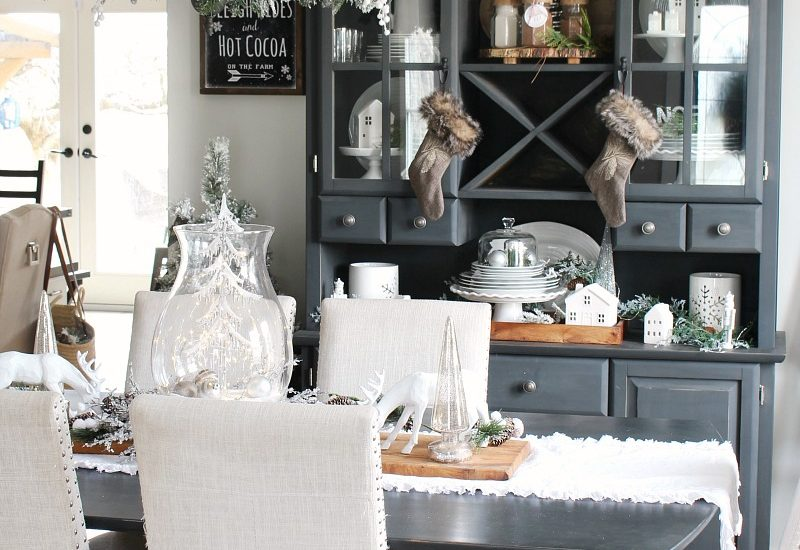 Farmhouse style Christmas dining room decor with black buffet and hutch.