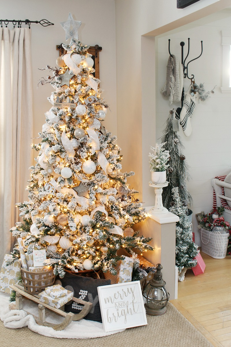 Flocked Christmas tree decorated with metallics and neutrals.