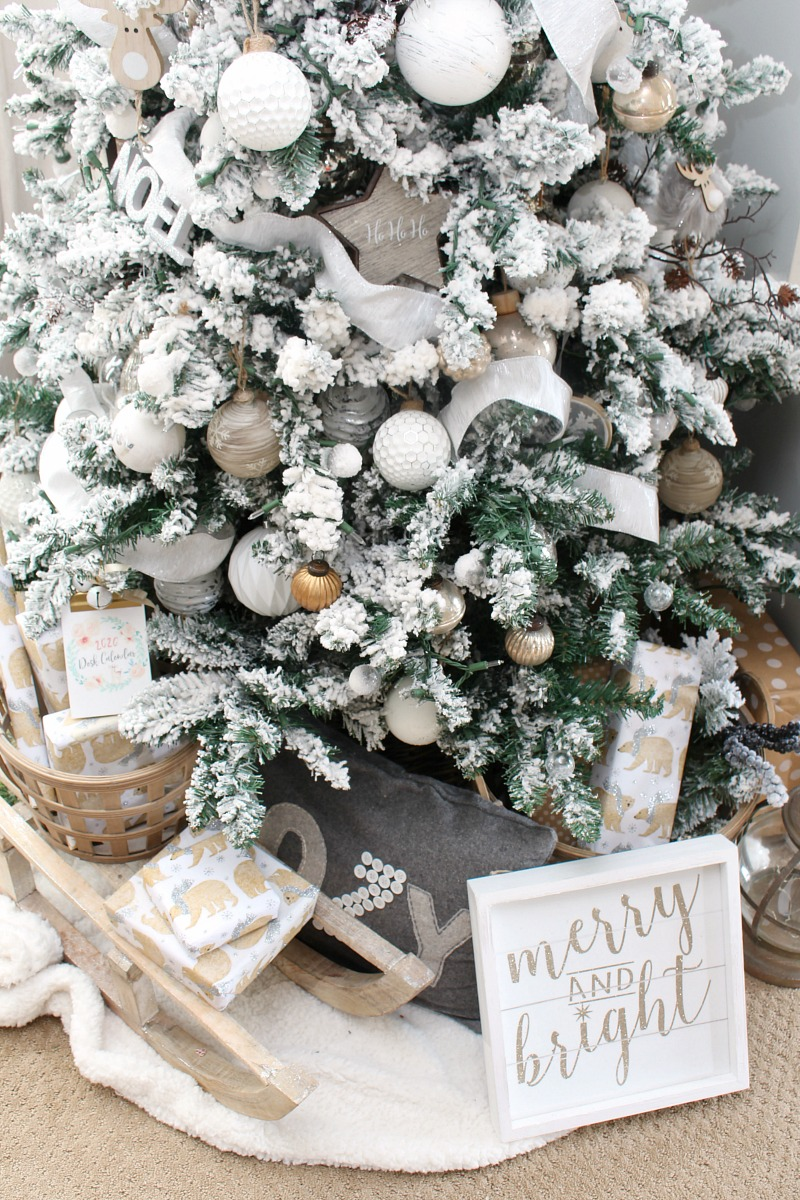 Beautiful flocked Christmas tree decorated with silver metallics and neutral colors.