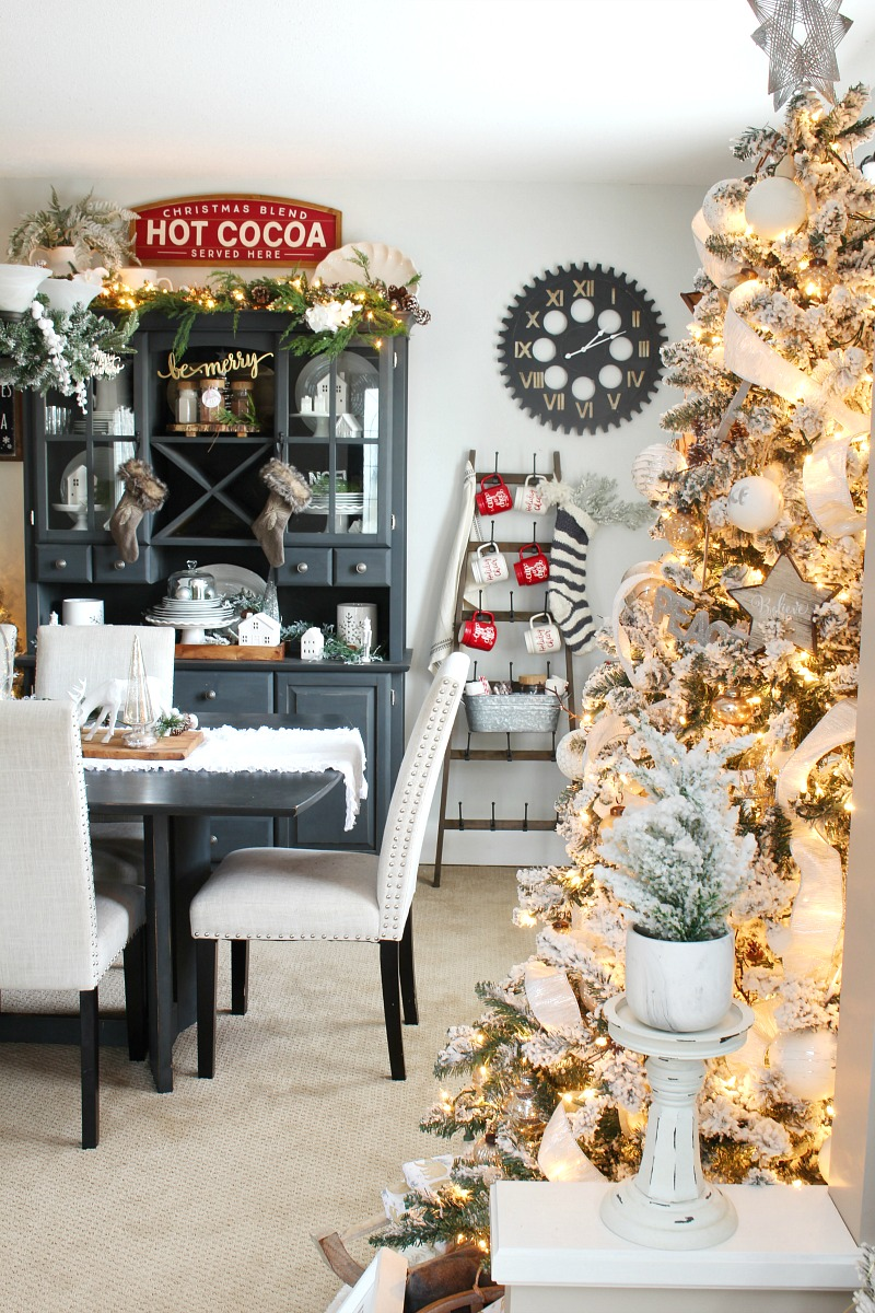 Beautiful Christmas dining room decor with flocked Christmas tree.