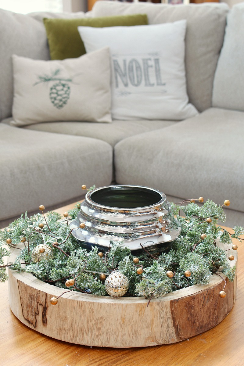 Wood bowl with a wreath and candle for an easy Christmas centerpiece.