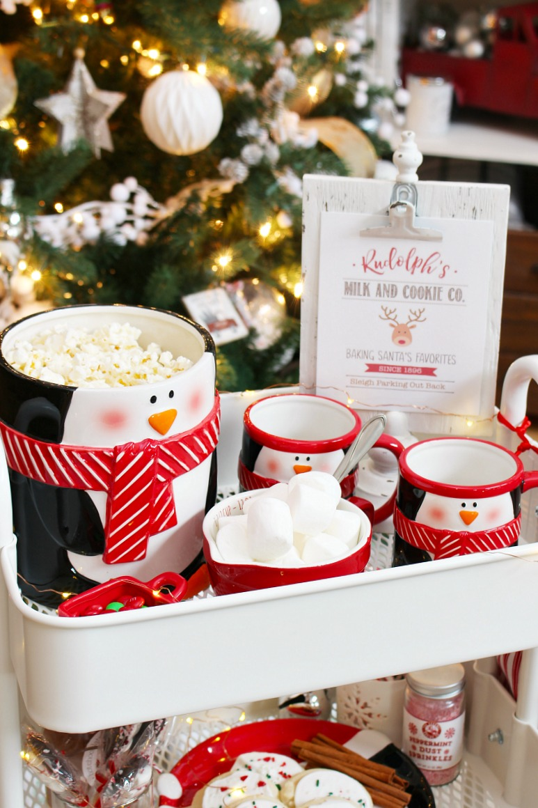 Christmas movie night cart with adorable penguin mugs and cookie jar.