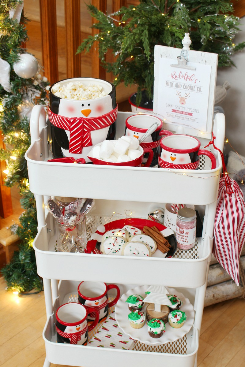 Rolling cart filled with Christmas treats and hot chocolate for a Christmas movie night.