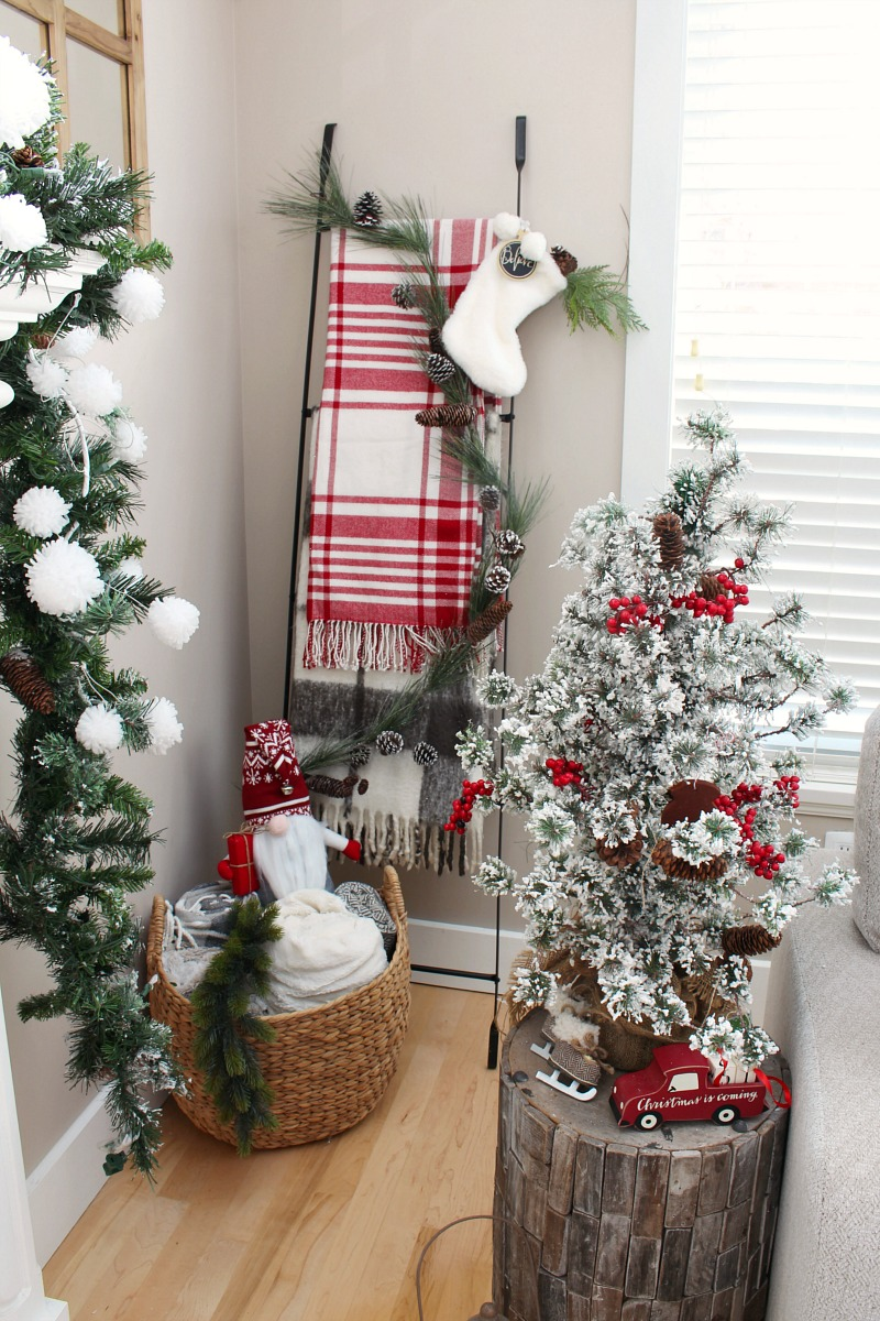 Blanket ladder with a red and white plaid blanket.